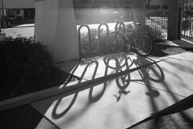 Late afternoon shadows at a bicycle rack